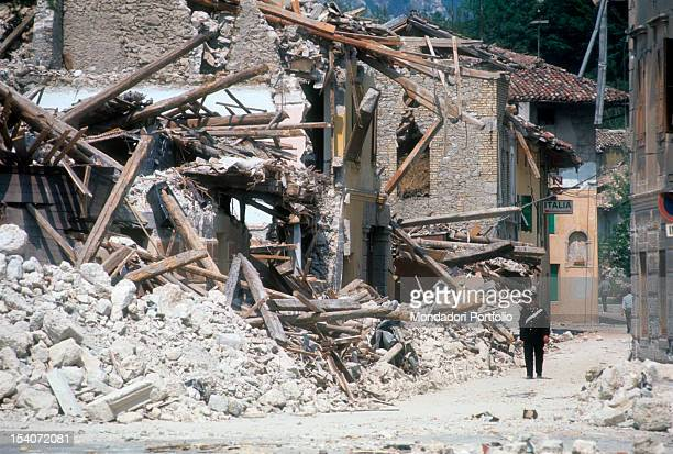 An Italian police officer walks through the ruins of the earthquake FriuliVenezia Giulia May 1976