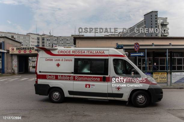 An Italian Red Cross ICU ambulance leaves the main entrance of the Cremona Hospital on March 20 2020 in Cremona near Milan Italy The Italian...