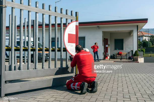 An Italian Red Cross member prepares to paint a railing of their headquarters during a break from work on April 4 2020 in the village of Villa dAlme...