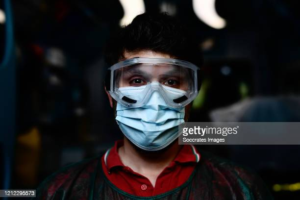 An Italian Red Cross volunteer wearing personal protective equipment poses for a photograph at a testing facility during the Coronavirus COVID-19...