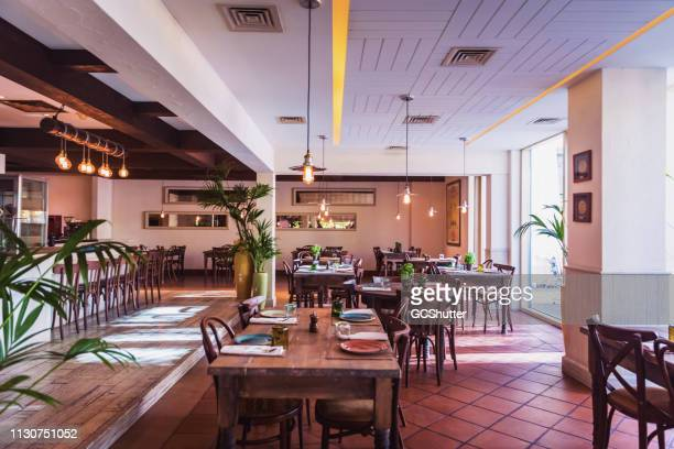 an italian restaurant interior setup - restaurant stock pictures, royalty-free photos & images