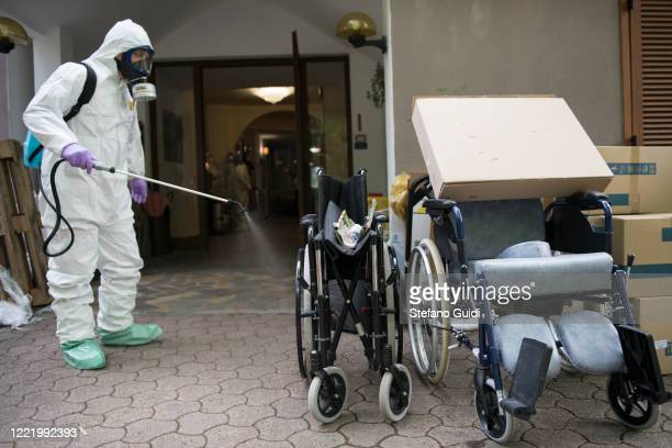 An Italian soldier carry out a disinfection operation against the coronavirus COVID19 at a home for the elderly on April 30 2020 in Turin Italy Italy...