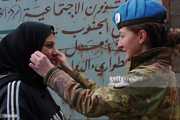 An Italian soldier from the United Nations Interim Force in Lebanon chats with a Muslim Lebanese woman January 22, 2007 in Tibnine, South Lebanon....