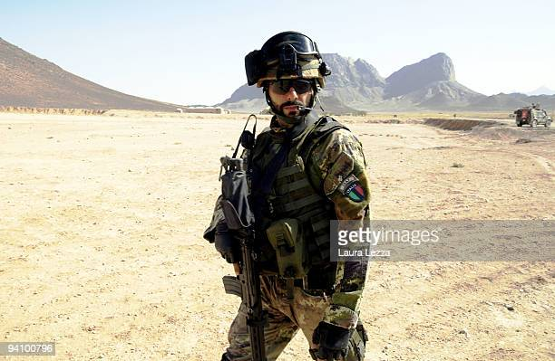 An Italian soldier of the Folgore Parachute Brigade patrolling the area near the checkpoint on the Highway 517 during a daily operation on September...