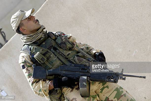 An Italian soldier patrols the town of Nassiriyah, 375 kms southeast Baghdad 05 July 2004. Italy has nearly 3,000 men deployed in the region of...