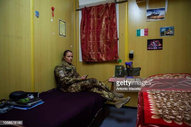 An Italian soldier sits in her room and gets ready to go at work on November 7 2018 in Herat Afghanistan The Italian instructors of Italian Army in...