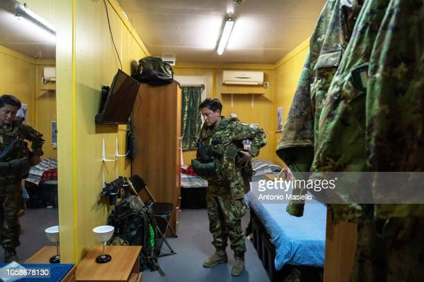 An Italian soldier stands in her room and gets ready to go at work on November 7 2018 in Herat Afghanistan The Italian instructors of Italian Army in...