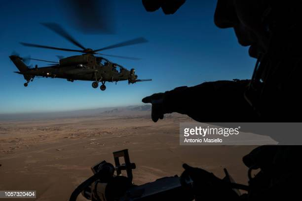 An Italian soldier takes part in an aerial reconnaissance with NH90 and Mangusta helicopters under the banner of Nato Resolute Support mission on the...