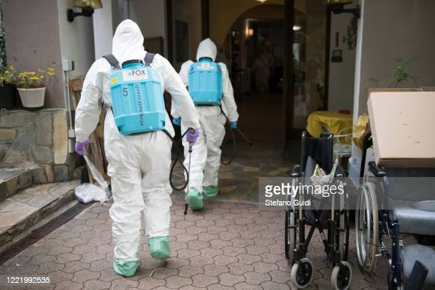 An Italian soldiers carry out a disinfection operation against the coronavirus COVID19 at a home for the elderly on April 30 2020 in Turin Italy...