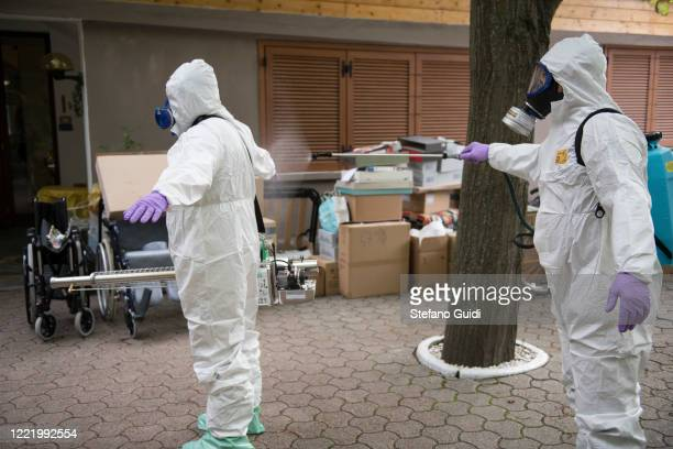 An Italian soldiers disinfect themselves after carrying out a disinfection operation against the coronavirus COVID19 at a home for the elderly on...