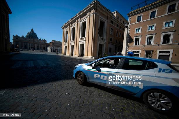 An Italian State police car patrols across Via della Conciliazione in Rome near the Vatican's St. Peter's Square , during the lockdown within the new...