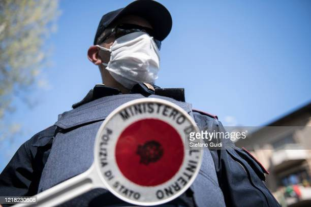 An Italian state police officer is seen at a checkpoint on April 11 2020 in Turin Italy There have been well over 100000 reported COVID19 cases in...