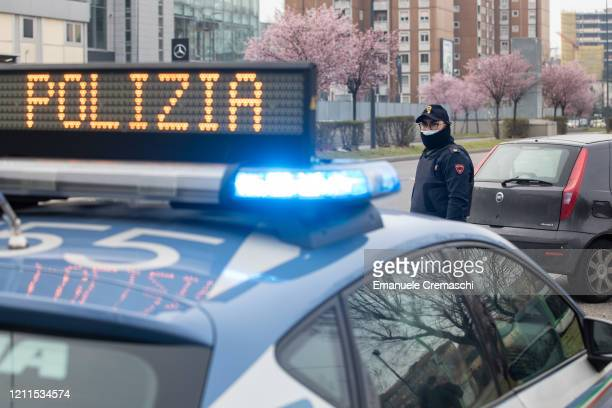 An Italian State Police officer looks on at a checkpoint on March 10, 2020 in Milan, Italy. The Italian Government has taken the unprecedented...