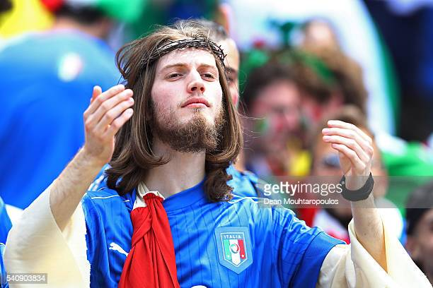 An Italian supporter enjoys the pre match atmosphere prior to the UEFA EURO 2016 Group E match between Italy and Sweden at Stadium Municipal on June...