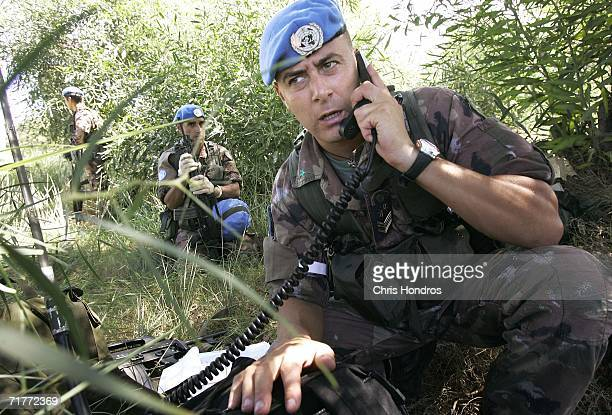 An Italian United Nations peacekeeper communicates via radio after landing by helicopter on September 2, 2006 in Tyre, Lebanon. Italian troops landed...