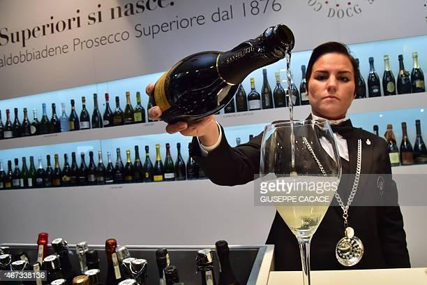 An Italian vendor serves Prosecco Valdobbiane superior on March 23 2015 at the Vinitaly exposition in Verona AFP PHOTO / GIUSEPPE CACACE