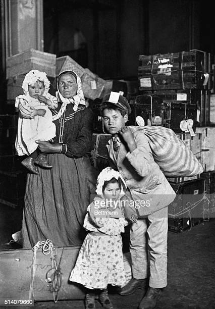 An Italian woman and her children arrive at Ellis Island, New York, May 1908. They are Anna Schiacchitano from Sicily and her children Paolo , Mary...
