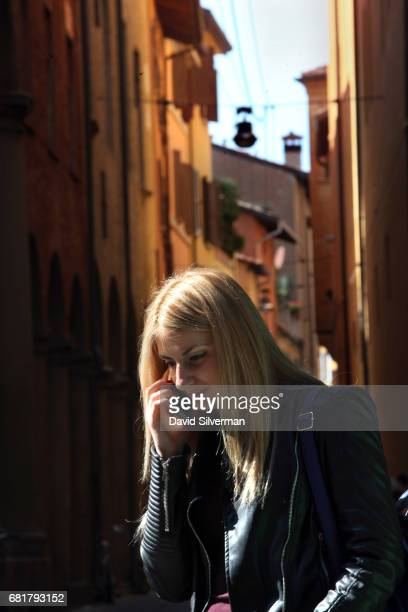 An Italian woman uses her mobile phone on March 31 2017 in Bologna Italy Italy's mobile market has one of the highest penetration rates in Europe...