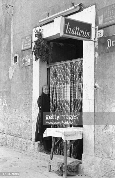 An Italian woman waiting for some customers at the entrance of a trattoria Castelvetrano 1950s