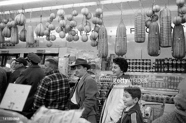 An ItalianAmerican family shopping in a supermarket in Brooklyn New York March 1956