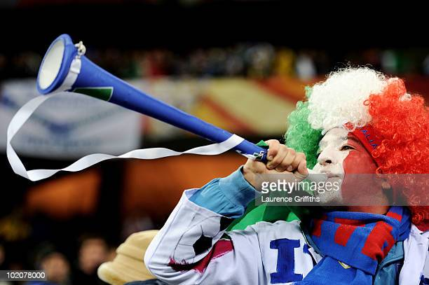 An Italy fan blows a vuvuzela prior to the 2010 FIFA World Cup South Africa Group F match between Italy and Paraguay at Green Point Stadium on June...