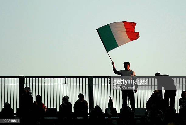 An Italy fan waves his national flag during the 2010 FIFA World Cup South Africa Group F match between Italy and New Zealand at the Mbombela Stadium...
