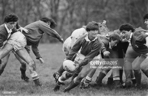 An Italy player passes the ball out to the backs during play in the plate semi-final match between Canada and Italy in the 1991 Women's Rugby World...
