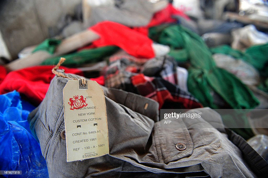An item of clothing with a 'Joe Fresh' label lies in the rubble after an eight-storey building collapsed in Savar, on the outskirts of Dhaka, on May 2, 2013. Bangladesh authorities have suspended the mayor of Savar satellite town outside the capital for approving the faulty construction of a building that collapsed last week, killing 429 people. AFP PHOTO/ Munir uz ZAMAN