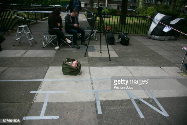 An ITN sign writen in tape siginifies the televison chanels' spot near the tower June 16th 2017 London United Kingdom Grenfell Tower burned out after...