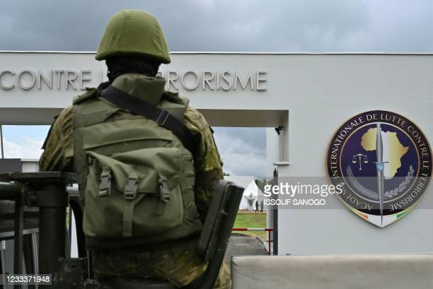 An Ivorian soldier sits on a vehicle during the inauguration of the International Academy for Combating Terrorism in Jacqueville in Ivory Coast on...