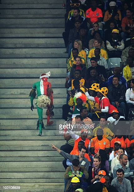An Ivory Coast fan enjoys the atmosphere during the 2010 FIFA World Cup South Africa Group G match between North Korea and Ivory Coast at the...
