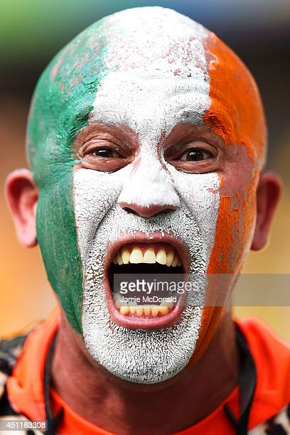 An Ivory Coast fan enjoys the atmosphere prior to kickoff during the 2014 FIFA World Cup Brazil Group C match between Greece and the Ivory Coast at...