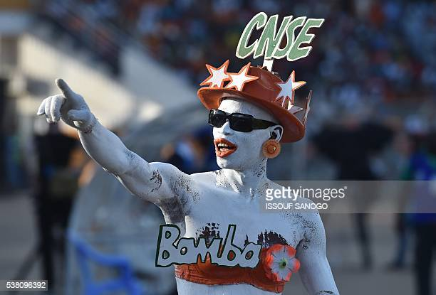 TOPSHOT An Ivory Coast's supporter gestures during the 2017 African Cup of Nations qualification football match between Ivory Coast and Gabon at the...