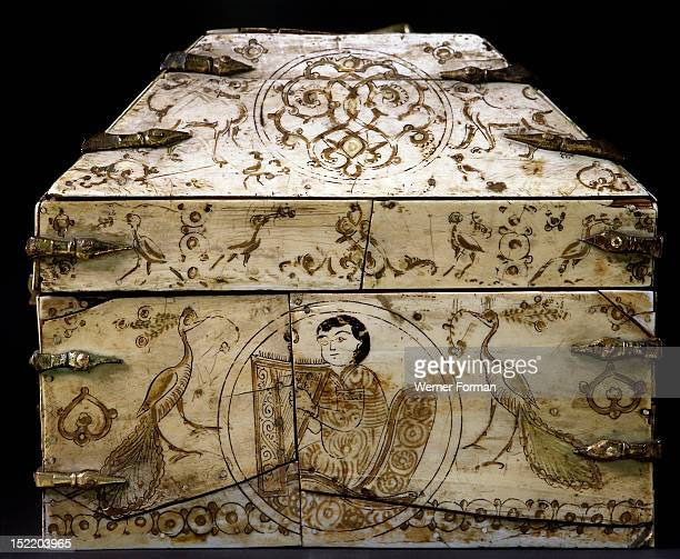 An ivory covered wooden casket with a painted design including two peacocks and a seated musician playing a harp Work in this style much of which was...