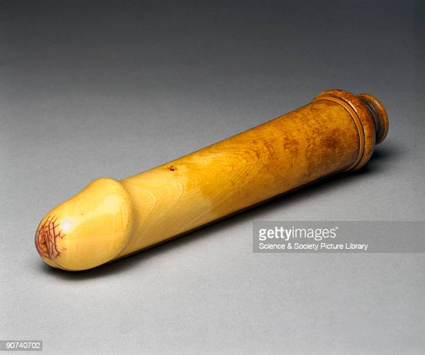 An ivory dildo in the form of an erect penis complete with a contrivance for simulating ejaculation