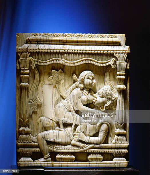 An ivory panel probably from a bed or a swing carved with a tantric scene of a couple making love India Hindu