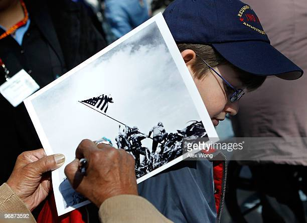 An Iwo Jima veteran signs autograph on the famous WWII photograph Raising the Flag on Iwo Jima shot by AP photographer Joe Rosenthal for Michael...