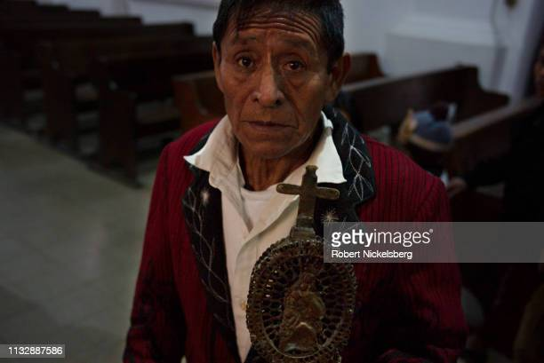 An Ixil Maya carries a wooden staff during a Day of the Epiphany Sunday mass in the Roman Catholic Iglesia Central in Nebaj, Guatemala on January 6,...