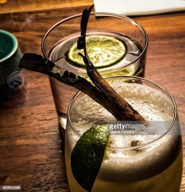 An 'Ixtepec' cocktail made with 'Mexicano' mezcal distilled in a clay pot spiced pepper syrup cloves star anise and pineapple juice with a toasted...