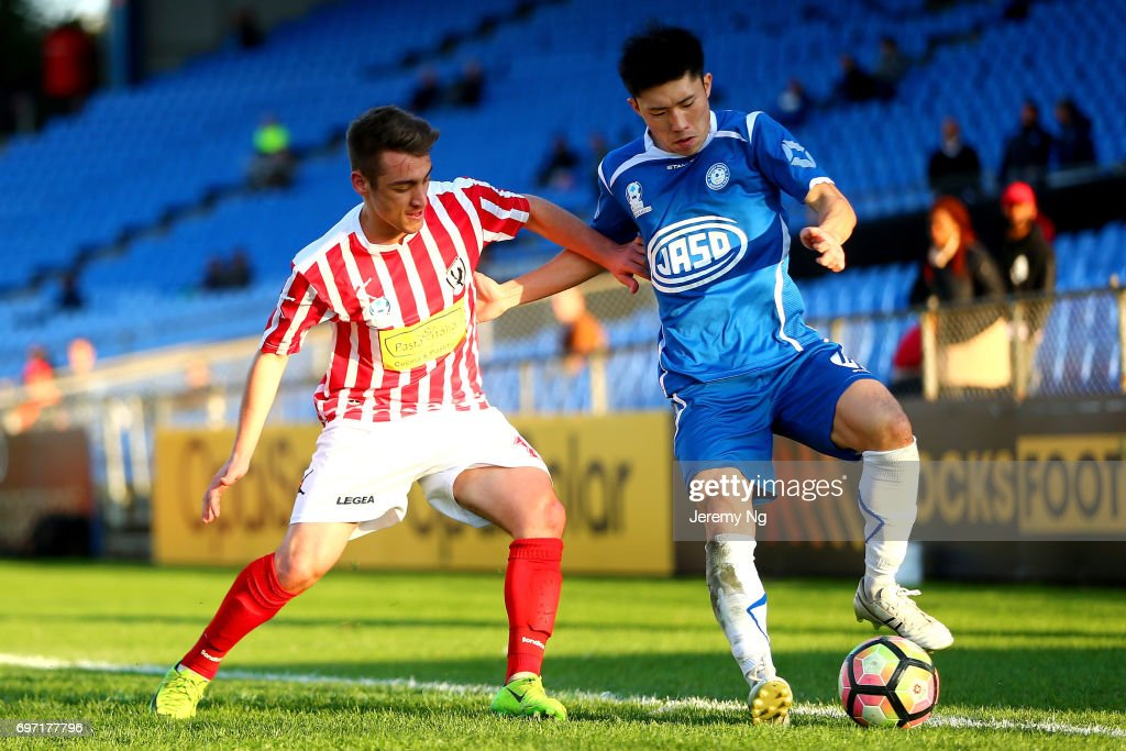 An Jinya of Olympic FC and Marcus Donatiello of Parramatta FC challenge for the ball during the NSW NPL Men's match between Sydney Olympic FC and Parramatta FC on June 18, 2017 in Sydney, Australia.