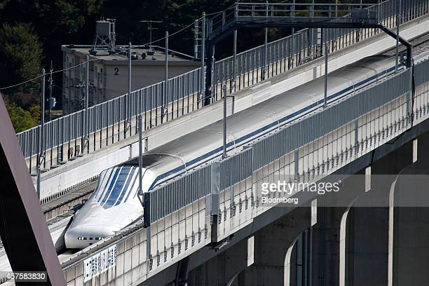 An L0 series magnetic levitation train developed by Central Japan Railway Co travels along on an elevated track during a trial run at the Yamanashi...