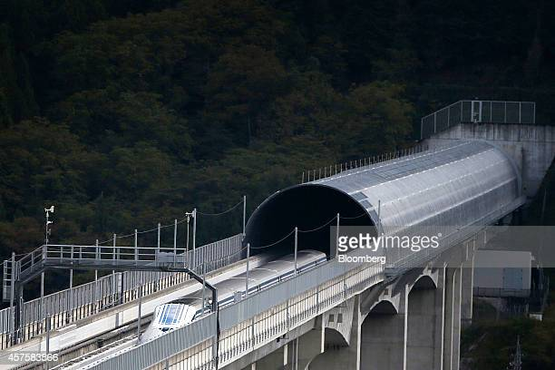 An L0 series magnetic levitation train developed by Central Japan Railway Co travels along on an elevated track during a trail run at the Yamanashi...