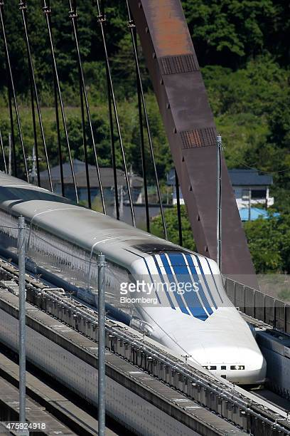 An L0 series magnetic levitation train developed by Central Japan Railway Co travels along on a track during a trial run at the Yamanashi Maglev Test...