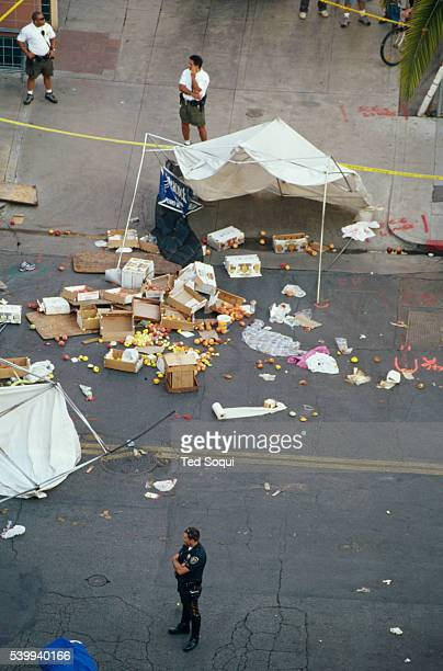 An LAPD policeman stands guard at the site of the deadly Santa Monica Farmer's Market crash that killed 10 people and injured 63 others George...
