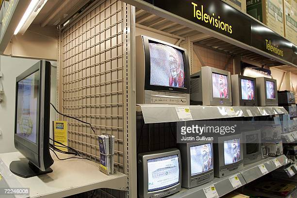 An LCD flat panel television is seen on display near older CRT tube televisions at a Best Buy store October 23 2006 in Marin City California...
