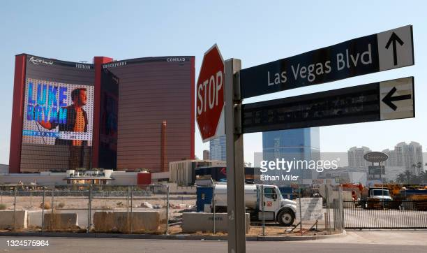 An LED screen displays an advertisement for Luke Bryan's upcoming residency as construction continues at Resorts World Las Vegas north of a sign...