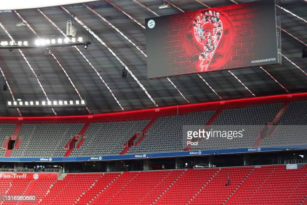 "An LED Screen inside the stadium displays the number ""9"" for their ninth league title in a row prior to the Bundesliga match between FC Bayern..."