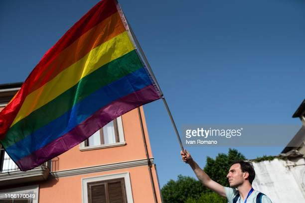 An LGBT activist waves the flag with the colors of the rainbow during the Avellino Pride 2019 on June 15 2019 in Atripalda Italy Abellinum Pride 2019...