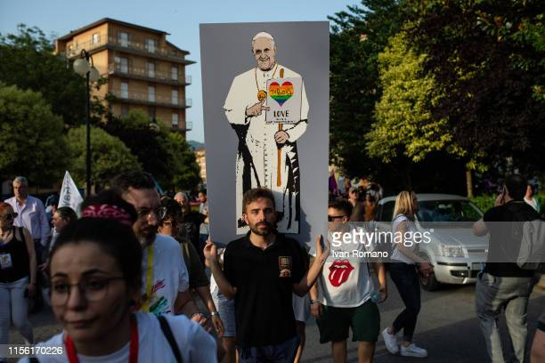 An LGBT activist with a poster on which Pope Francis is drawn with a heart in the colors of the rainbow during the Avellino Pride 2019 on June 15...