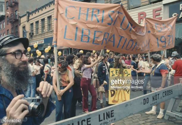 An LGBT parade through New York City on Christopher Street Gay Liberation Day reaches a police line 1971
